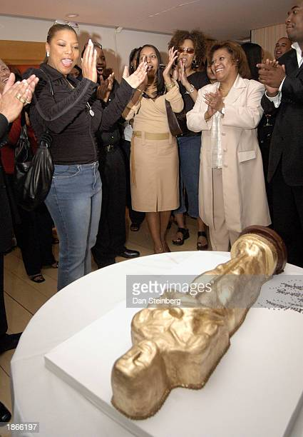 Singer and actress Queen Latifah admires her Oscar statuette shaped birthday cake at her surprise birthday and preOscar dinner at the Mondrian hotel...