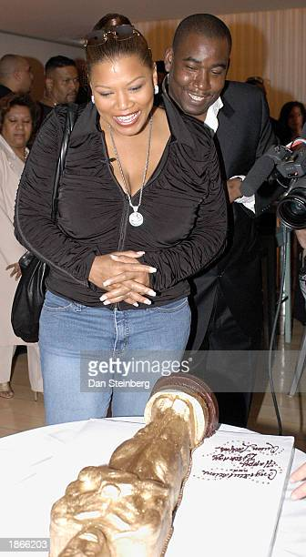 Singer and actress Queen Latifah admires her Oscar statuette shaped birthday cake at her surprise birthday and preOscar party at the Mondrian hotel...