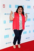 Singer and actress Raini Rodriguez from the television show 'Austin Ally' poses for photos on the red carpet during 'We Day' at the Allstate Arena on...