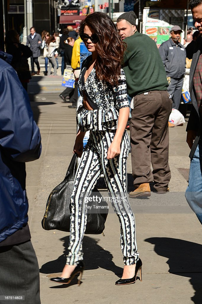 Singer and actress Selena Gomez enters the ABC Times Square Studios on April 25, 2013 in New York City.