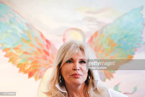 Singer and artist Amanda Lear poses at the 'Amanda Lear Evolution' exhibition opening at Galerie Claudius on August 7 2013 in Hamburg Germany