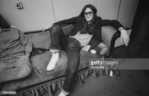 Singer and bassist Geddy Lee of Canadian progressive rock band Rush backstage at the Hammersmith Odeon London during the 'A Farewell To Kings' tour...