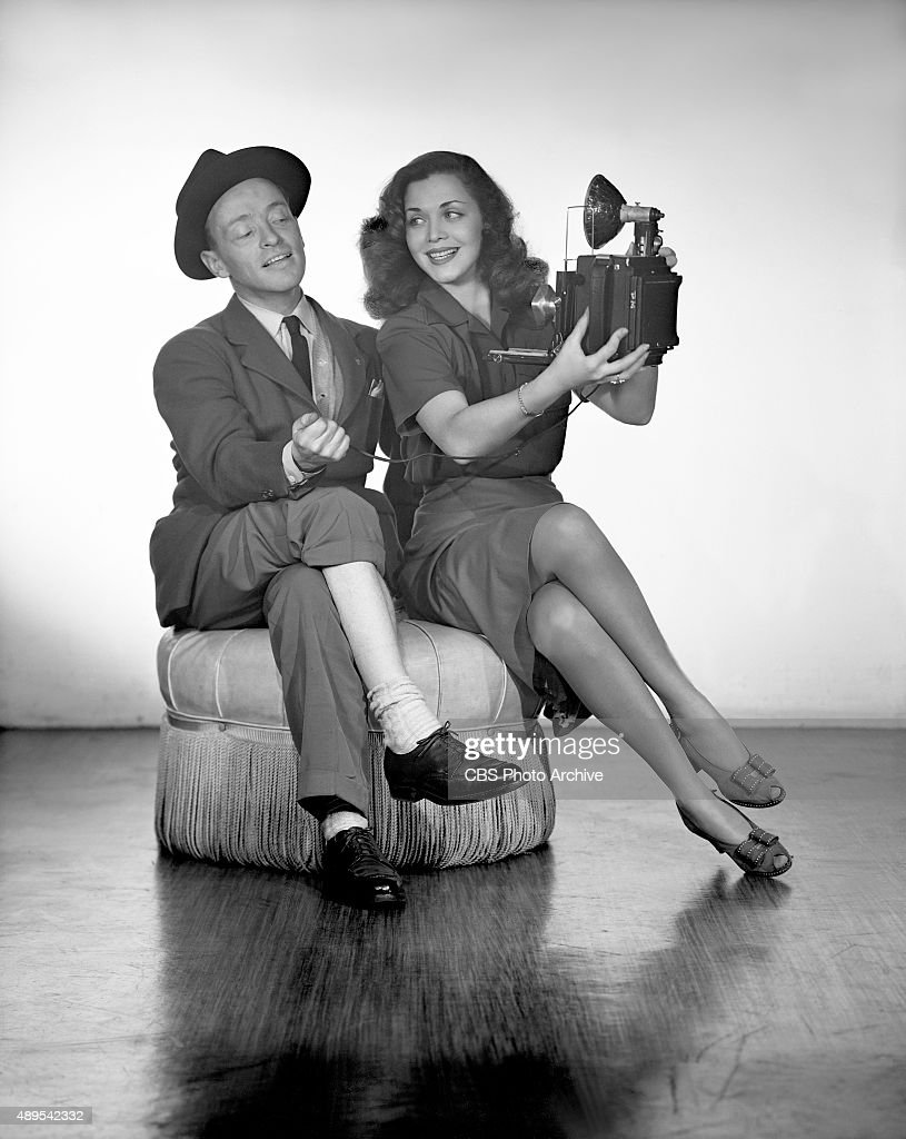 CBS RADIO - Singer and Broadway performer, Carol Bruce, with her press agent, poses for a 'selfie' gag shot. Photo dated: February 1, 1944.