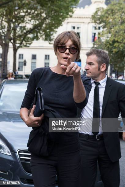 Singer and former French First Lady Carla Bruni Sarkozy attends Mireille Darc's Funeral at Eglise Saint Sulpice on September 1 2017 in Paris France...