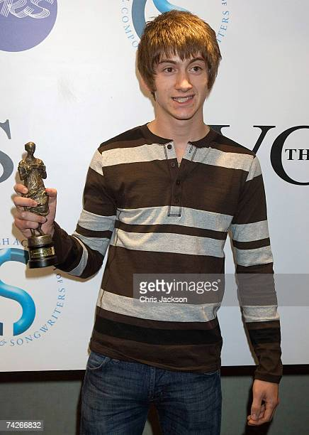 Singer and front man Alex Turner of the Arctic Monkeys poses with his award for Best Album at the Ivor Novello Awards at the Grovesnor House Hotel on...