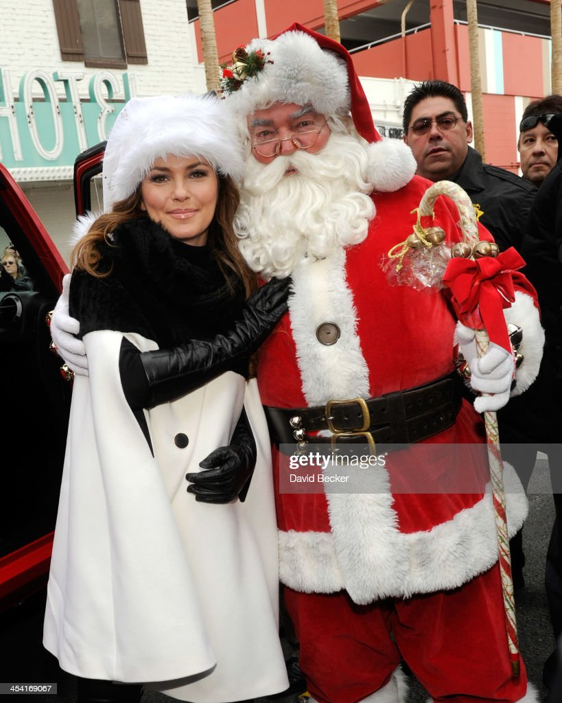 Singer and grand marshal <a gi-track='captionPersonalityLinkClicked' href=/galleries/search?phrase=Shania+Twain&family=editorial&specificpeople=203173 ng-click='$event.stopPropagation()'>Shania Twain</a> (L) arrives with a Santa Claus character at the ninth annual Las Vegas Great Santa Run benefiting Opportunity Village on December 7, 2013 in Las Vegas, Nevada.