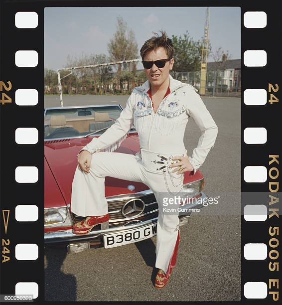 Singer and guitarist Bernard Sumner of English rock group New Order wearing an Elvisstyle jumpsuit after the group recorded the official song of the...