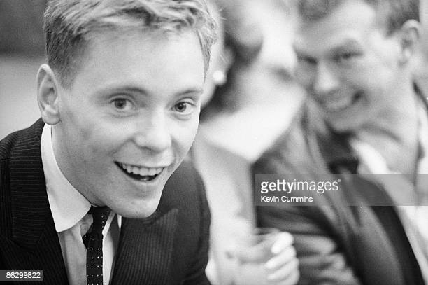 Singer and guitarist Bernard Sumner of English rock group New Order at The Hacienda nightclub Manchester 20th May 1983 On the right is former Warsaw...
