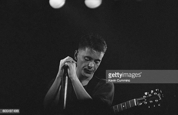 Singer and guitarist Bernard Sumner performing with English rock group New Order at the Hacienda Manchester 26th January 1983