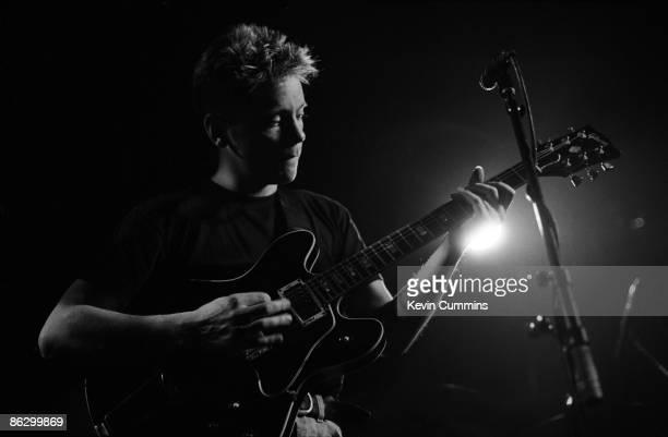 Singer and guitarist Bernard Sumner performing with English rock group New Order at Salford University 17th April 1985