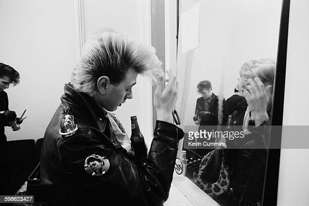 Singer and guitarist Brian Setzer of American rockabilly band the Stray Cats backstage at Manchester University 7th March 1981 On the left and...