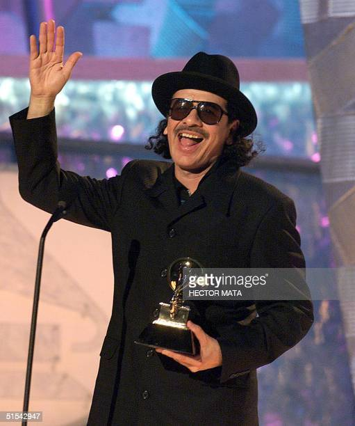 Singer and guitarist Carlos Santana gives thanks for the Grammy he won on the Best Pop Instrumental Performance category for his song 'El Farol'...