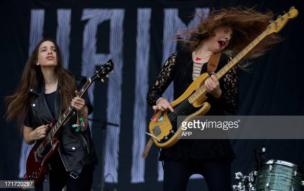 US singer and guitarist Danielle Haim and US singer and bass player Este Haim perform in the band Haim on the Pyramid Stage on the third day of the...