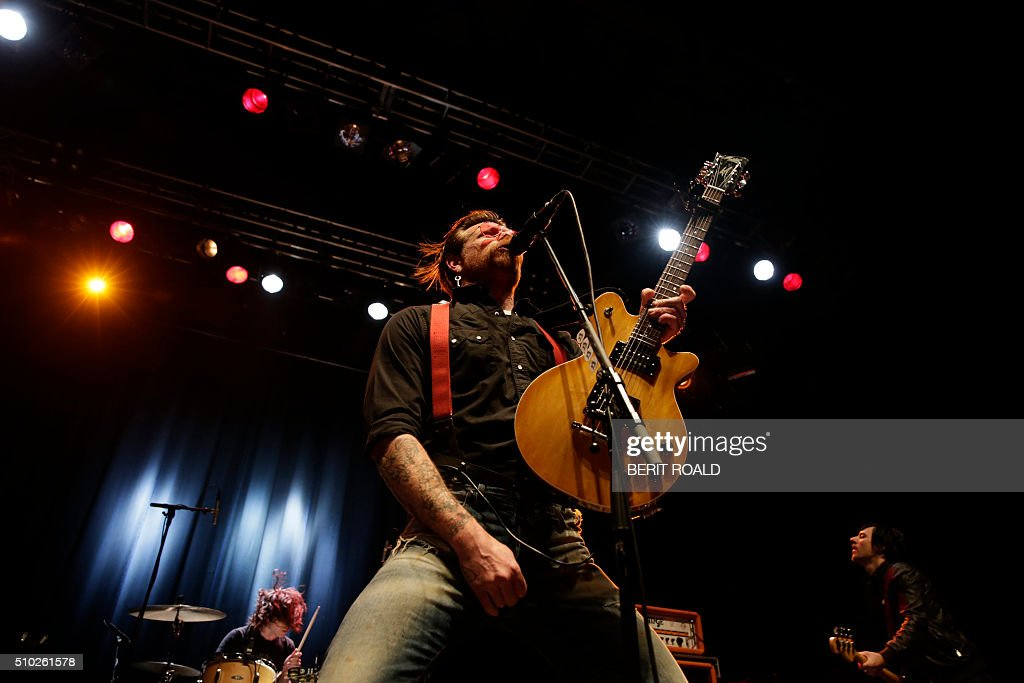 Singer and guitarist of US rock band Eagles of Death Metal, Jesse Hugues, performs on stage at the Sentrum Scene concert hall in Oslo on February 14, 2016. / AFP / NTB Scanpix / BERIT ROALD / Norway OUT