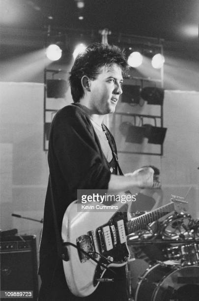 Singer and guitarist Robert Smith performing with English pop group The Cure at Manchester Polytechnic 6th November 1980