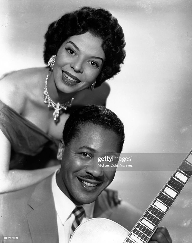 Singer and guitarist Steve Gibson of the R and B combo 'Steve Gibson And The Red Caps' poses for a portrait with his wife and vocalist Damita Jo who was in the band from 1954-60 in circa 1955 in New York, New York.