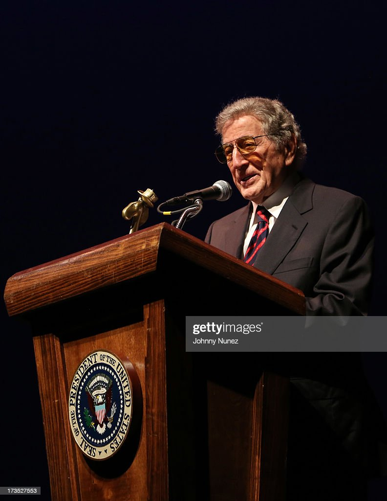 Singer and honored guest <a gi-track='captionPersonalityLinkClicked' href=/galleries/search?phrase=Tony+Bennett+-+Singer&family=editorial&specificpeople=160951 ng-click='$event.stopPropagation()'>Tony Bennett</a> speaks at the New York County Democratic Committee Award Ceremony at American Airlines Theater on July 15, 2013 in New York City.