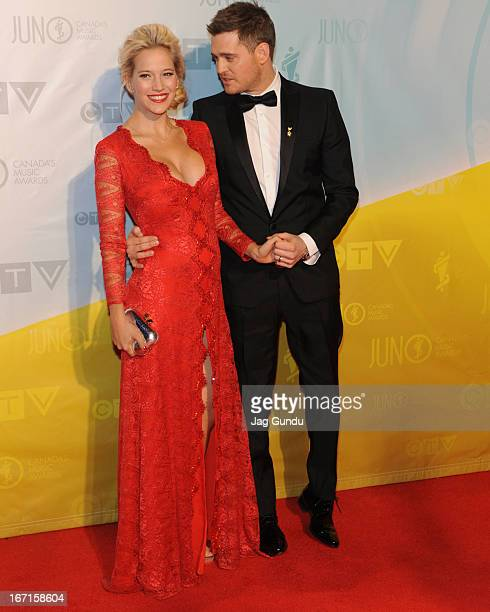Singer and host of the 2013 Juno Awards Michael Buble and his wife Luisana Lopilato arrive on the red carpet at the Brandt Centre on April 21 2013 in...