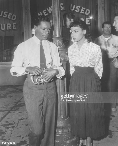 Singer and Jazz musician Nat King Cole and AfricanAmerican playwright actress poet and activist Ruby Dee during filming of the movie St Louis Blues...