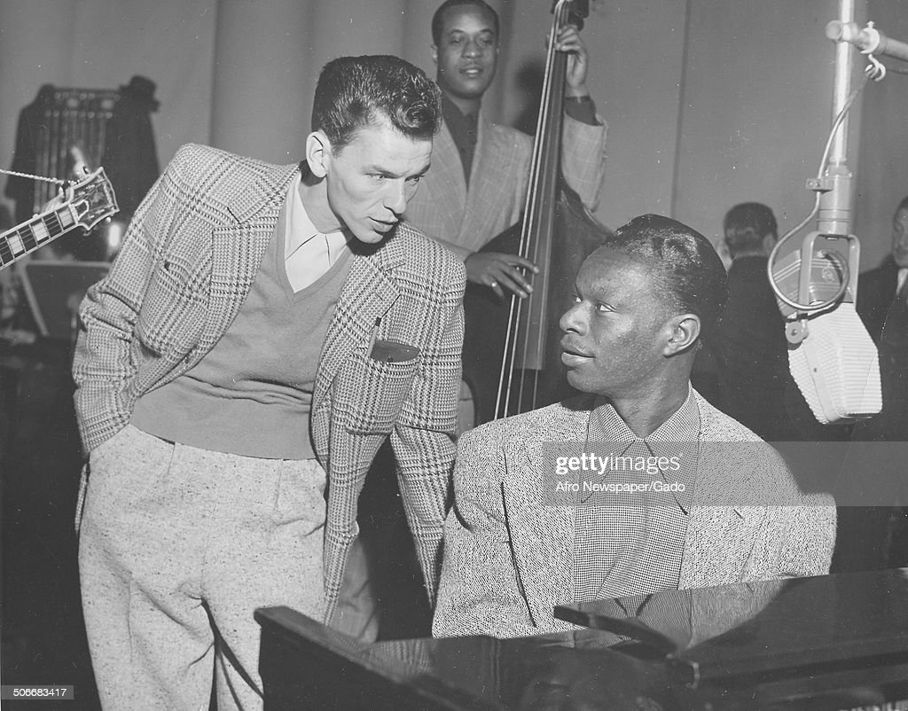 Singer and Jazz musician <a gi-track='captionPersonalityLinkClicked' href=/galleries/search?phrase=Nat+King+Cole&family=editorial&specificpeople=217991 ng-click='$event.stopPropagation()'>Nat King Cole</a> and singer <a gi-track='captionPersonalityLinkClicked' href=/galleries/search?phrase=Frank+Sinatra&family=editorial&specificpeople=70024 ng-click='$event.stopPropagation()'>Frank Sinatra</a> playing music during a radio show, December, 1945.