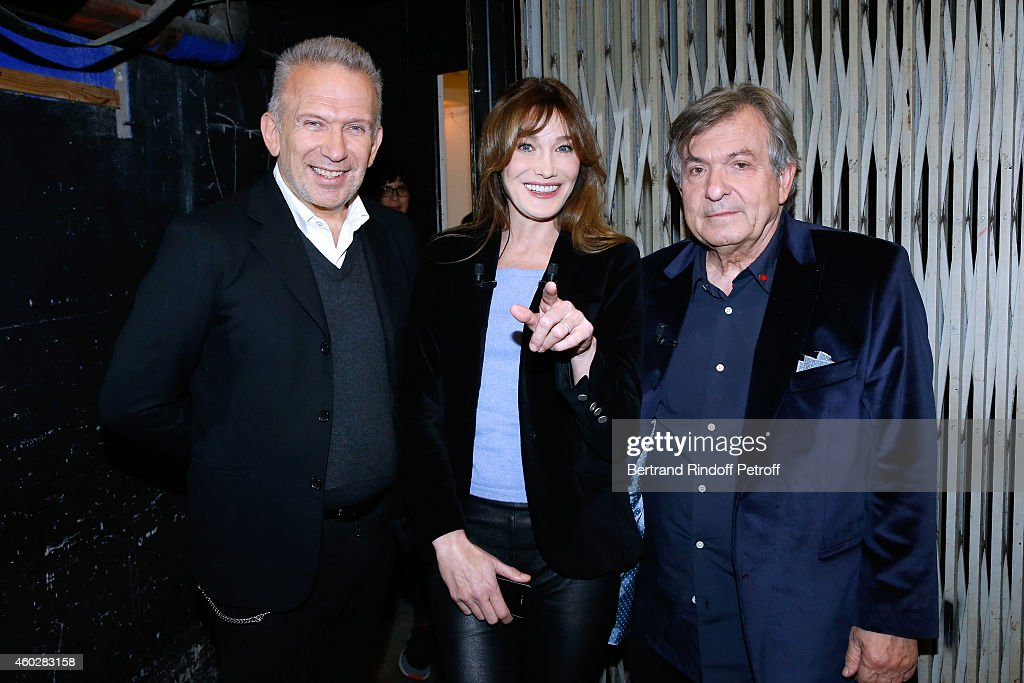 Singer and main guest of the show <a gi-track='captionPersonalityLinkClicked' href=/galleries/search?phrase=Carla+Bruni&family=editorial&specificpeople=235729 ng-click='$event.stopPropagation()'>Carla Bruni</a> who presents the DVD '<a gi-track='captionPersonalityLinkClicked' href=/galleries/search?phrase=Carla+Bruni&family=editorial&specificpeople=235729 ng-click='$event.stopPropagation()'>Carla Bruni</a> a l'Olympia' standing between Doctor Jacques Leibowitch (L) and Fashion designer Jean-Paul Gaultier who present 'Le Projet ICCARE Association' Against AIDS during the 'Vivement Dimanche' French TV at Pavillon Gabriel on December 10, 2014 in Paris, France.