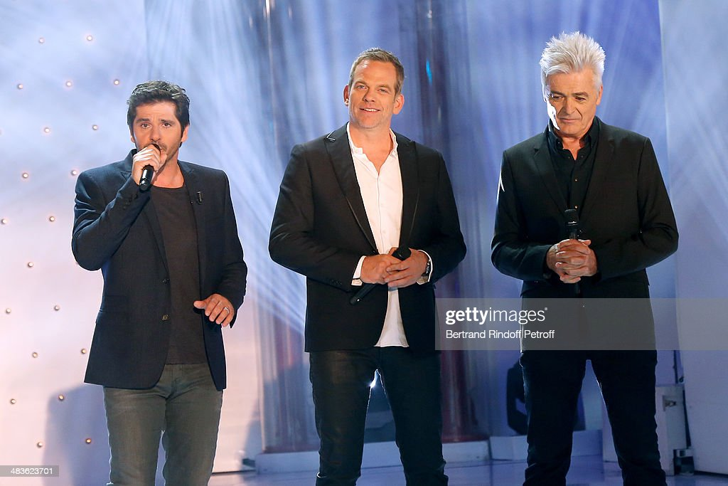 Singer and main guest of the show Patrick Fiori, singers Garou and Daniel Lavoie perform and sing 'Belle' at the 'Vivement Dimanche' French TV Show at Pavillon Gabriel on April 9, 2014 in Paris, France.