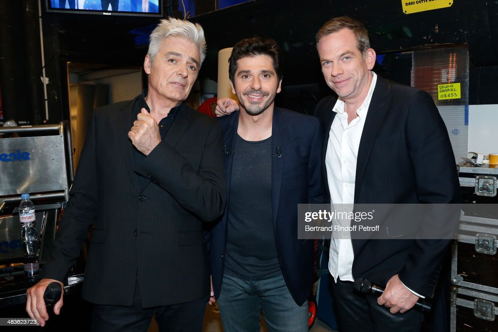 Singer and main guest of the show Patrick Fiori standing between singers Garou (R) and Daniel Lavoie (L) attend the 'Vivement Dimanche' French TV Show at Pavillon Gabriel on April 9, 2014 in Paris, France.