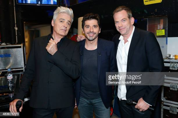 Singer and main guest of the show Patrick Fiori standing between singers Garou and Daniel Lavoie attend the 'Vivement Dimanche' French TV Show at...