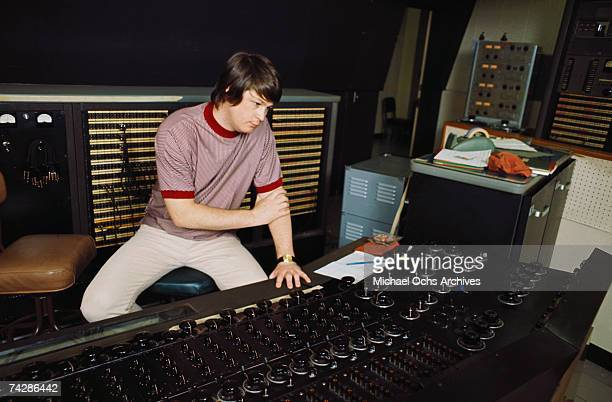 Singer and mastermind Brian Wilson of the rock and roll band 'The Beach Boys' directs from the control room while recording the album 'Pet Sounds' in...