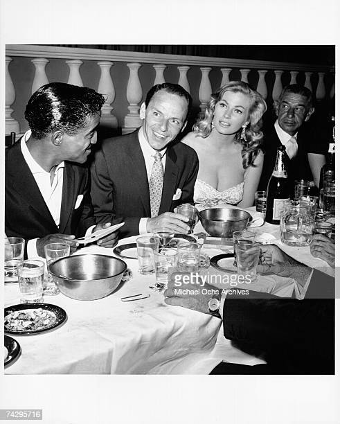 Singer and member of the Rat Pack Sammy Davis Jr Frank Sinatra actress Anita Ekberg and restauranteur Mike Romanoff dine at Romanoff's Restaurant on...