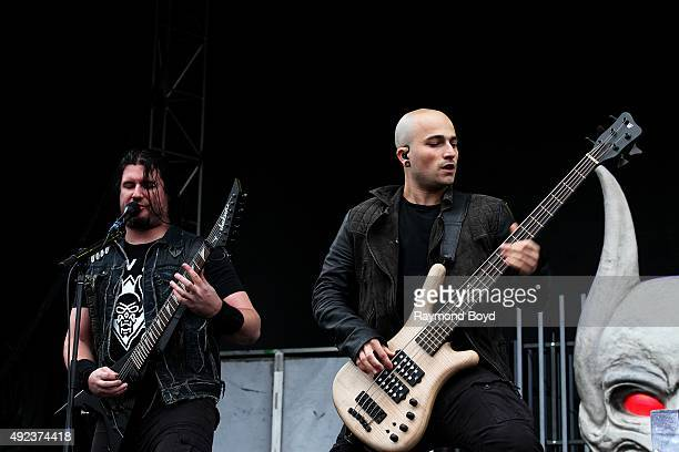 Singer and musician Corey Beaulieu and musician Paolo Gregoletto from Trivium performs during the 'Louder Than Life' festival at Champions Park on...