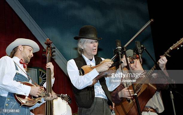 Singer and musician John Hartford performs with his band at a 2001 Grand Ole Opry show in Nashville Tennessee The live program was presented at the...