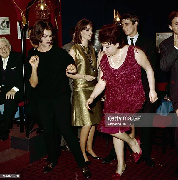 Singer And Night Clubs Owner Régine Dancing Twists with Actress Sophia Loren In Paris France circa 1960