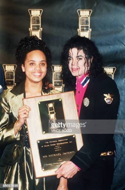 US singer and performer Michael Jackson with Jackie Jackson daughter of Reverand Jesse Jackson hold on to the National Association of Blackowned...