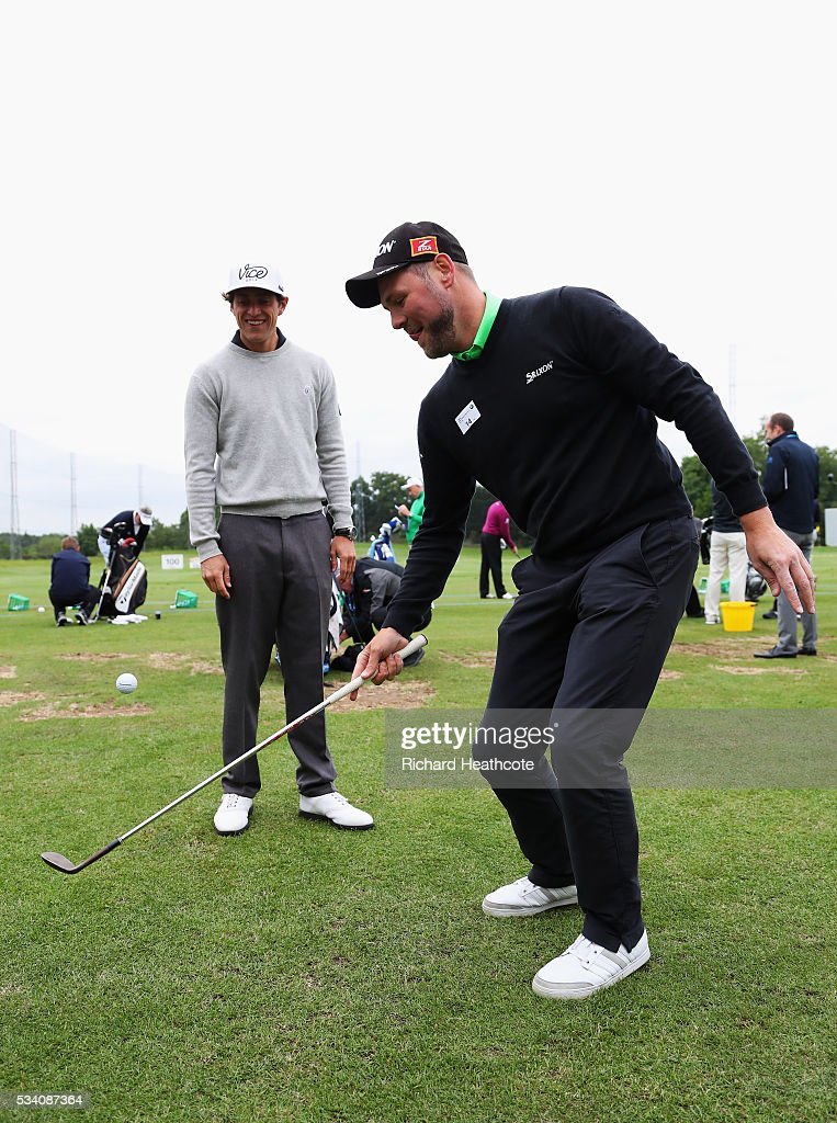 Singer and presenter Brian McFadden plays a trick shot watched by Romain Bechu during the Pro-Am prior to the BMW PGA Championship at Wentworth on May 25, 2016 in Virginia Water, England.