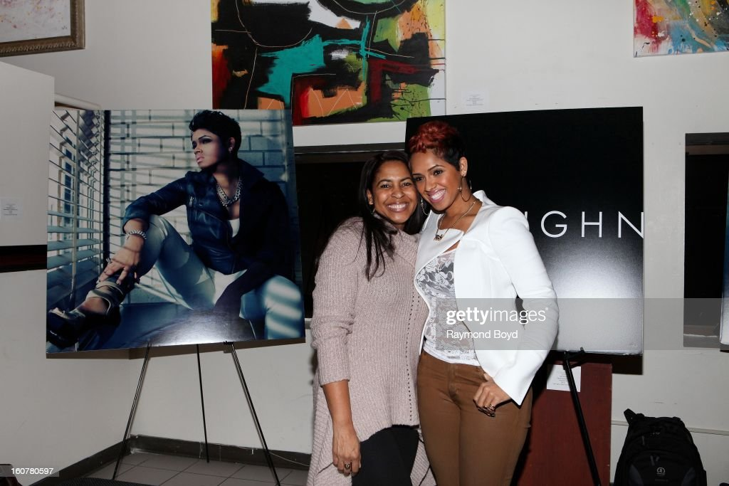 Singer and song writer RaVaughn, poses for photos with her mother Kotheldra Brown during 'The Experience With RaVaughn' at the DuSable Museum in Chicago, Illinois on FEBRUARY