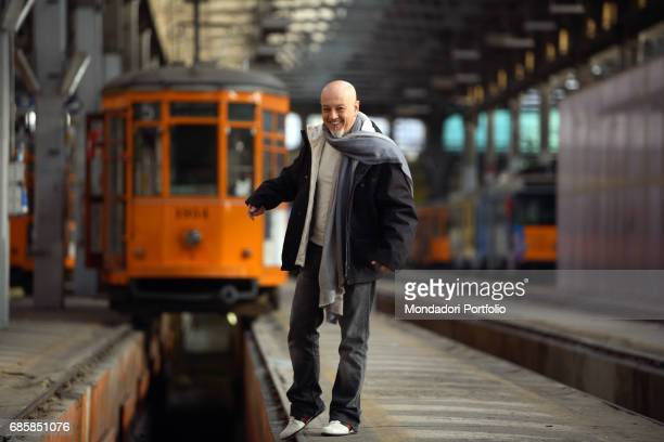 Singer and songwriter Enrico Ruggeri smiling in a tram station Italy 2005
