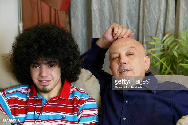 Singer and songwriter Enrico Ruggeri with his son Pier Enrico nicknamed Pico in his house Italy 2007