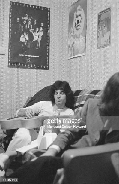 Singer and songwriter Freddie Mercury of British rock group Queen during an interview with the Daily Express at his Shepherds Bush flat London 1969