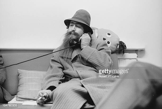 Singer and songwriter John Lennon of The Beatles in a false beard during filming of 'Help' directed by Richard Lester 1965