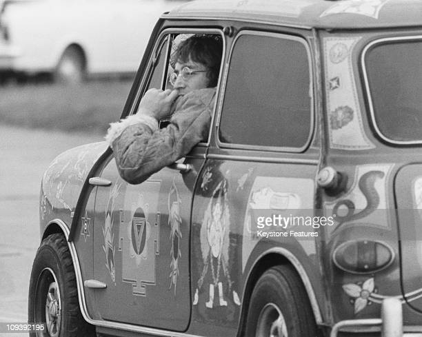 Singer and songwriter John Lennon of the Beatles in a psychedelic Radford Mini de Ville owned by George Harrison at West Malling Airfield Kent 7th...