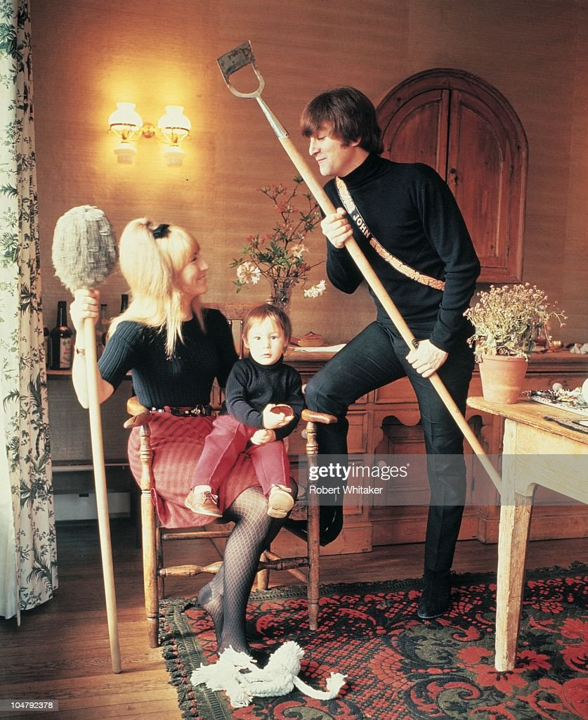 Singer and songwriter John Lennon (1940 - 1980) of The Beatles, with his first wife Cynthia and their son Julian, at their home at Kenwood, Weybridge, Surrey, 1964.