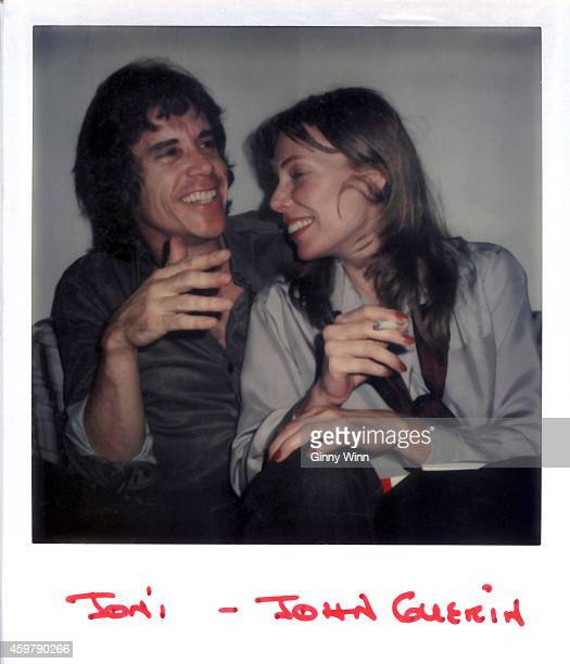 Singer and songwriter Joni Mitchell and drummer percussionist and session musician John Guerin in studio circa 1976 in Los Angeles California