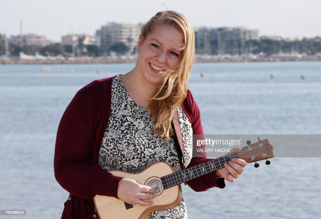 US singer and songwriter Julia Nunes poses during a photocall as part of the music world's largest annual trade fair, Midem on January 26, 2013 in Cannes, southeastern France. The Midem music trade show brings 7,000 of the global industry's biggest players together on the French Riviera for four days.