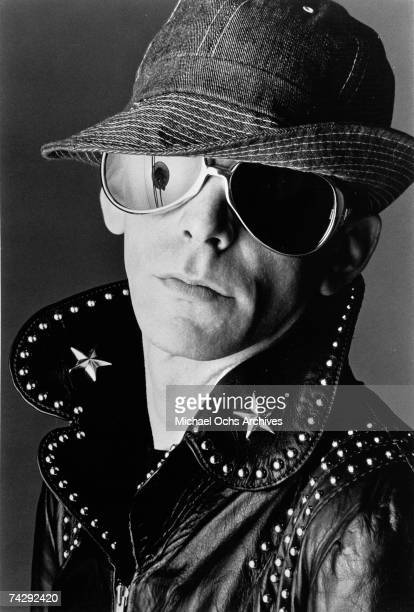 Singer and songwriter Lou Reed poses for a portrait wearing a hat sunglasses and a studded leather jacket for the cover of his album 'Lou Reed Live'...
