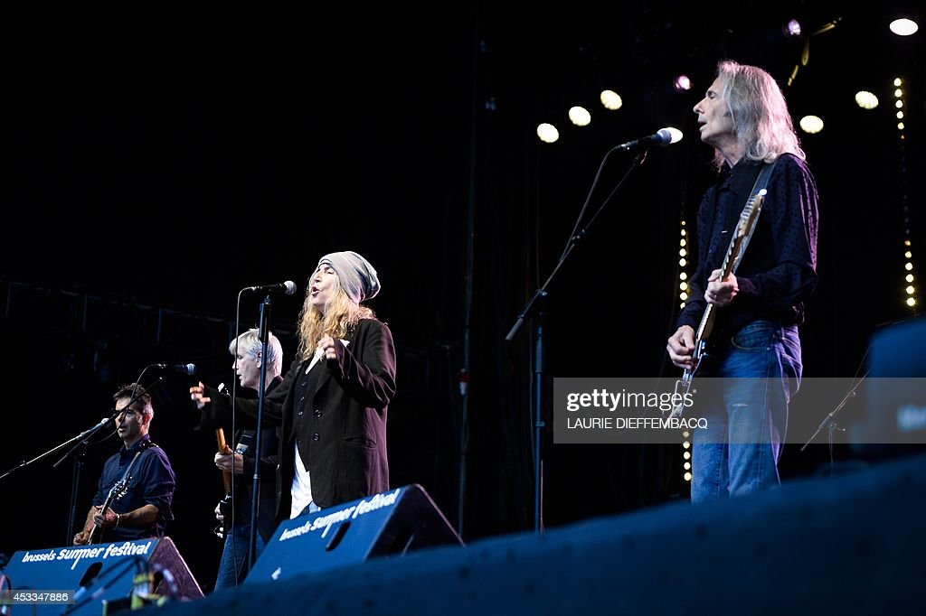 US singer and songwriter Patti Smith (3rd L) performs during the first day of the 13th edition of the Brussels Summer Festival, on August 8, 2014 in Brussels.