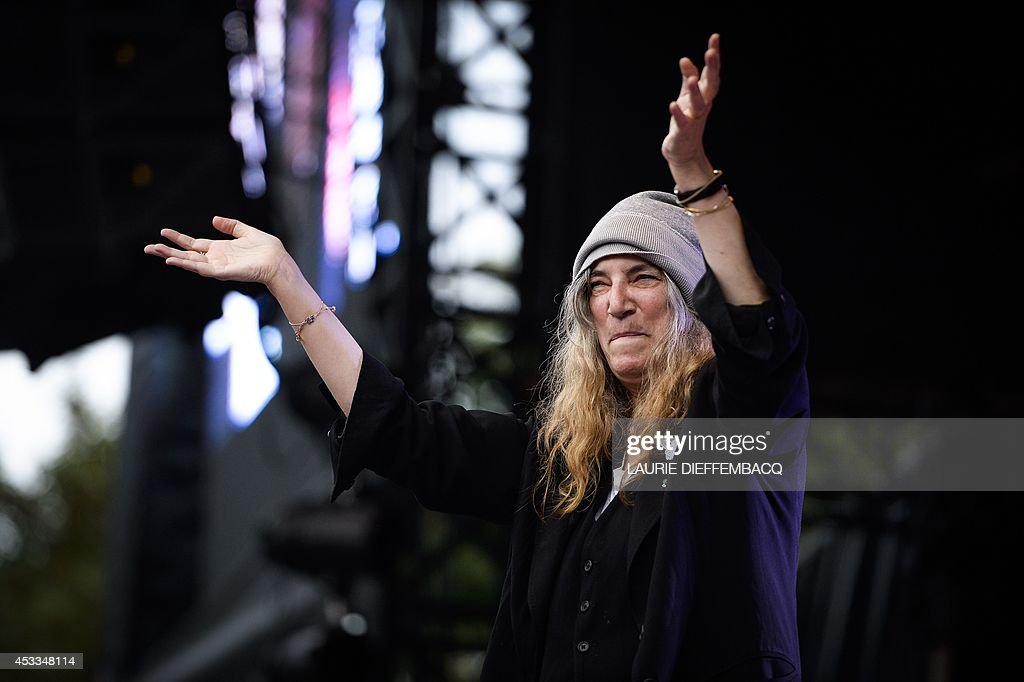 US singer and songwriter Patti Smith performs on stage during the first day of the 13th edition of the Brussels Summer Festival, on August 8, 2014 in Brussels.