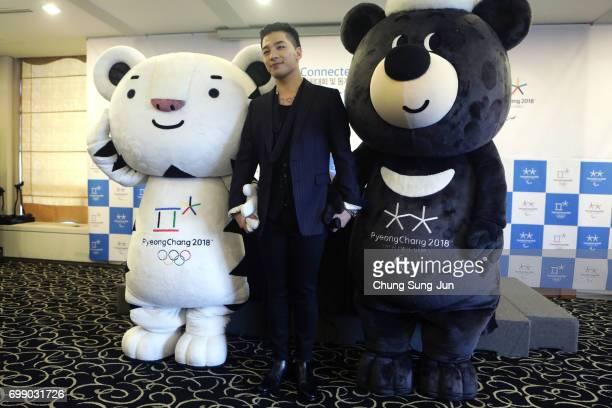 Singer and songwriter Taeyang of Big Bang attends with the mascots of the 2018 PyeongChang Winter Olympic and Paralympic Games Soohorang and Bandabi...