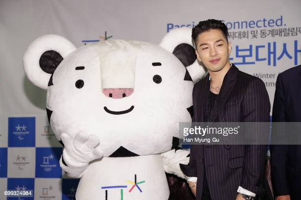 Singer and songwriter Taeyang of Big Bang attends with the mascots of the 2018 PyeongChang Winter Olympic and Paralympic Games Soohorang attend the...