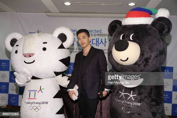 Singer and songwriter Taeyang of Big Bang attends with the mascots of the 2018 PyeongChang Winter Olympic and Paralympic Games Soohorang and Bandabi...